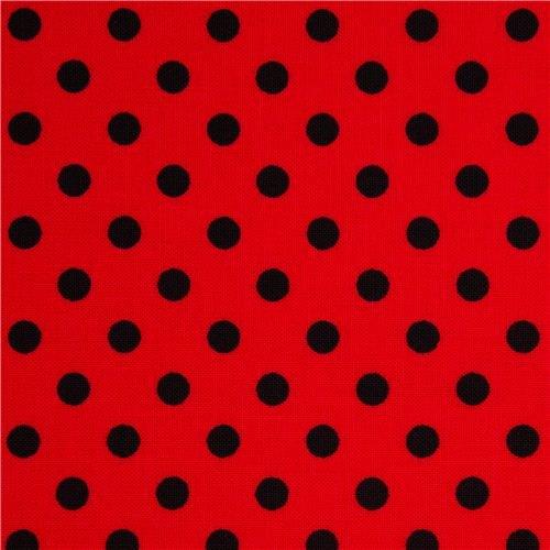 Černé tečky na červené